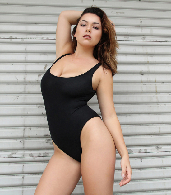 Curvy brunette teases in a tight leotard