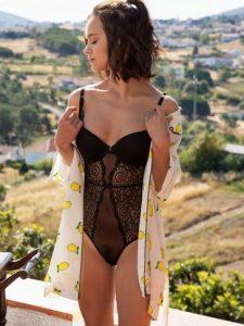 French model Marine Lecourt poses in black lingerie