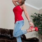 Nikki Sims in jeans and heels