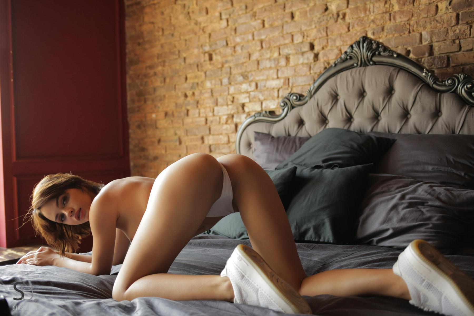 NatellaQ kneels on the bed with a nice view of her ass -StasyQ
